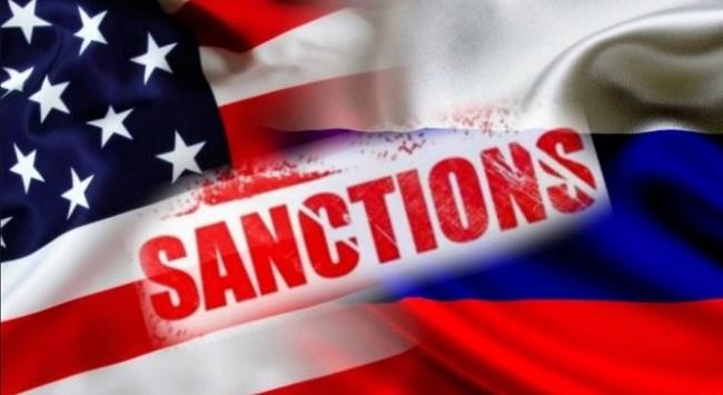 """Надпись """"Санкции"""" на флагах России и США"""