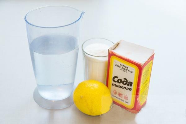 Лимон, сода, жидкость в стакане